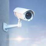 Echuca Moama Boat and Storage Solutions. Photo of a security camera on a grey wall with a blurred, blue background